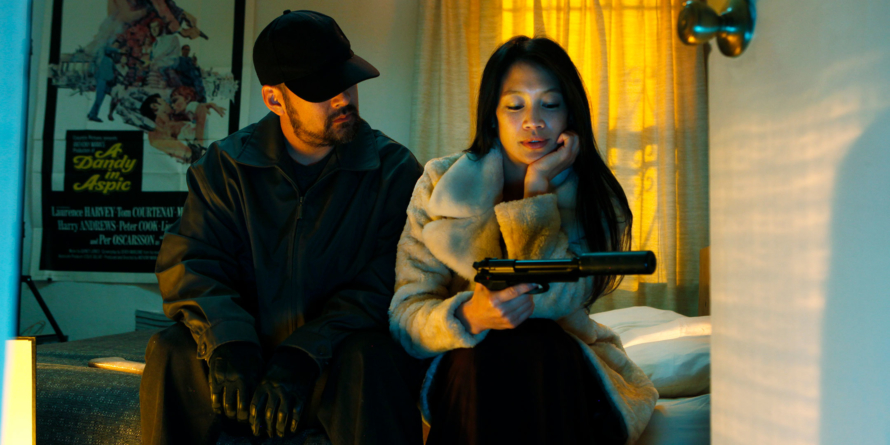 Michael Aki's Strangers and Brian L. Tan's Holdout to World premiere on December 7 at 8 pm